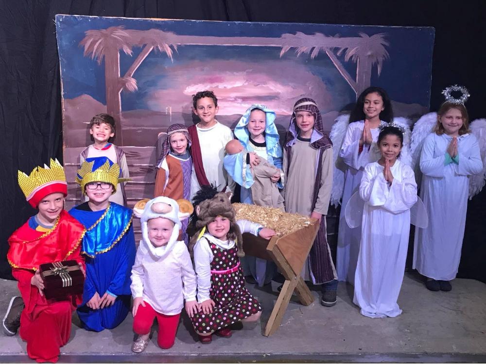 Children in a theatre performance