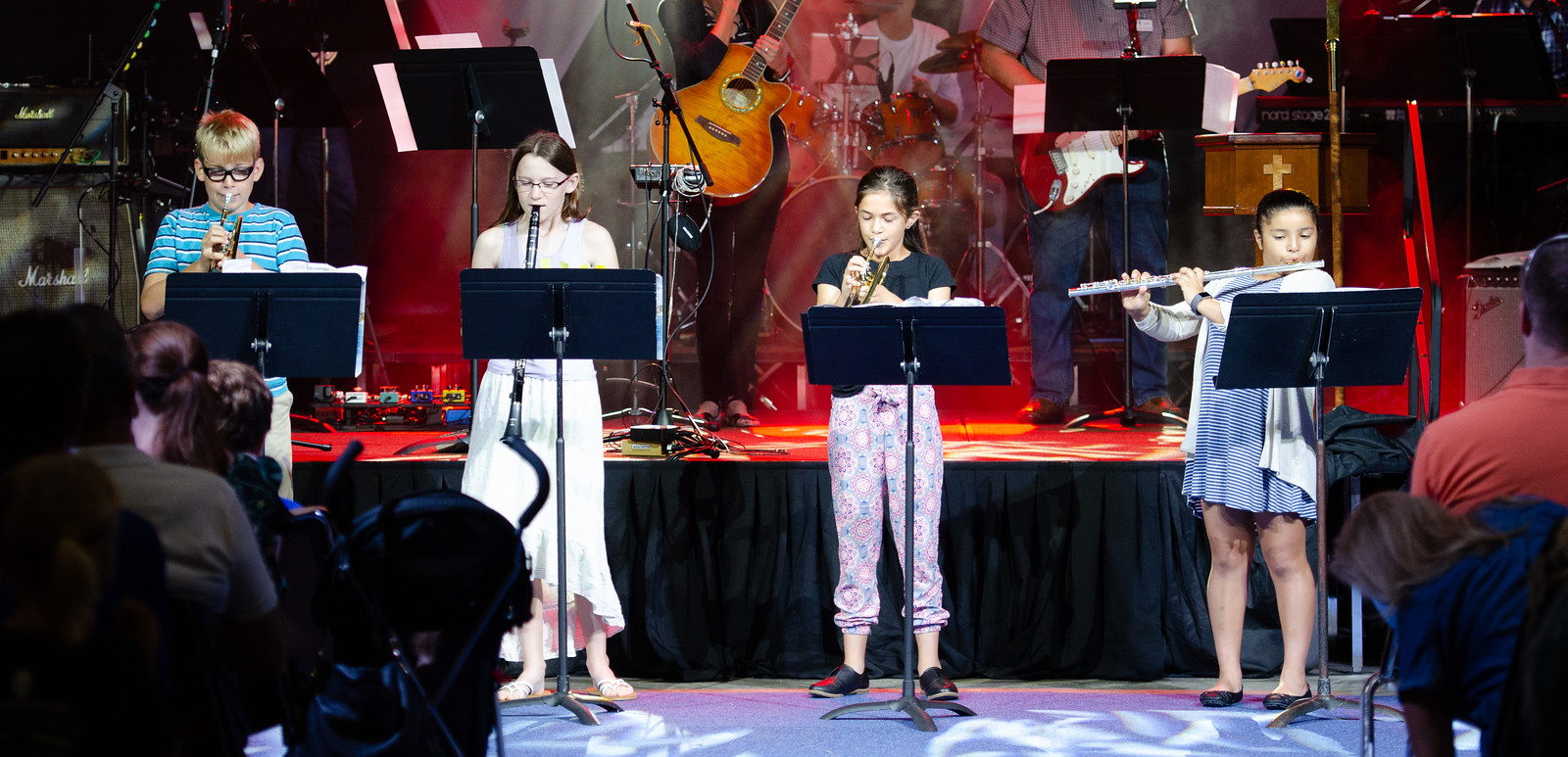 children playing instruments on stage