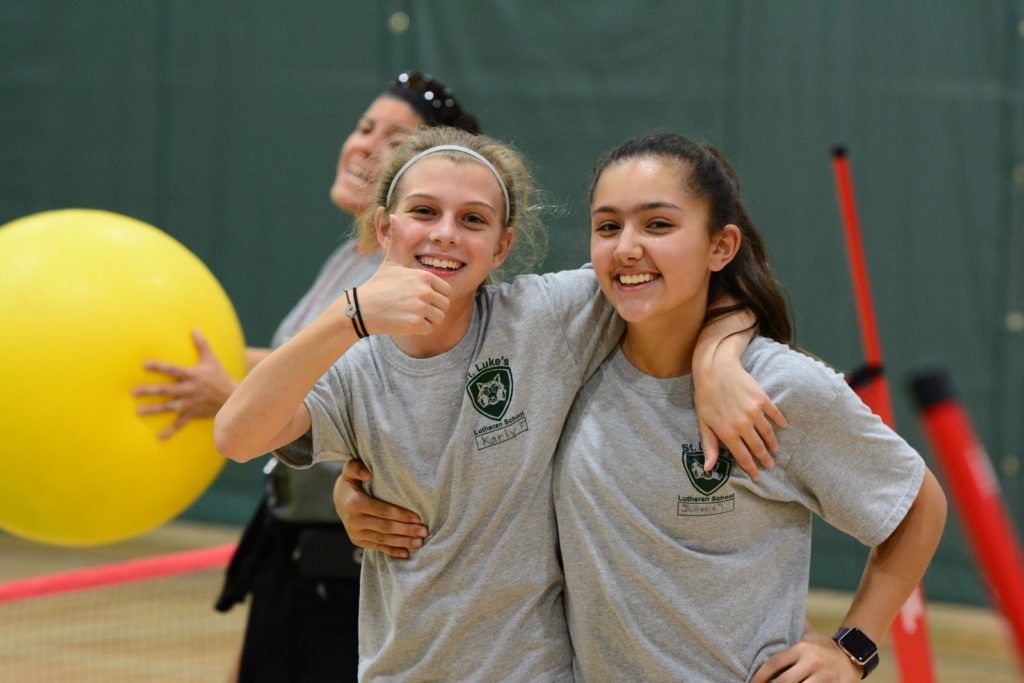 Two Middle Schoolers Smiling During P.E.